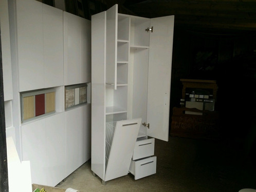 Tall cabinet 600mm with laundry basket | Wooden Garage Doors With ...