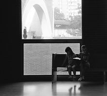 Students studying lines on bench.