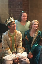 Rapunzel and Prince smile with audience member.