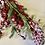 Thumbnail: Zasněžený trs červených bobulí, cesmíny a jehličí