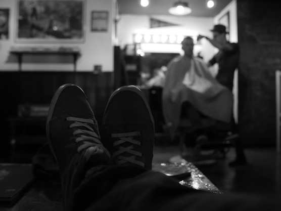 Client Kicking His Feet Up at the Barbershop