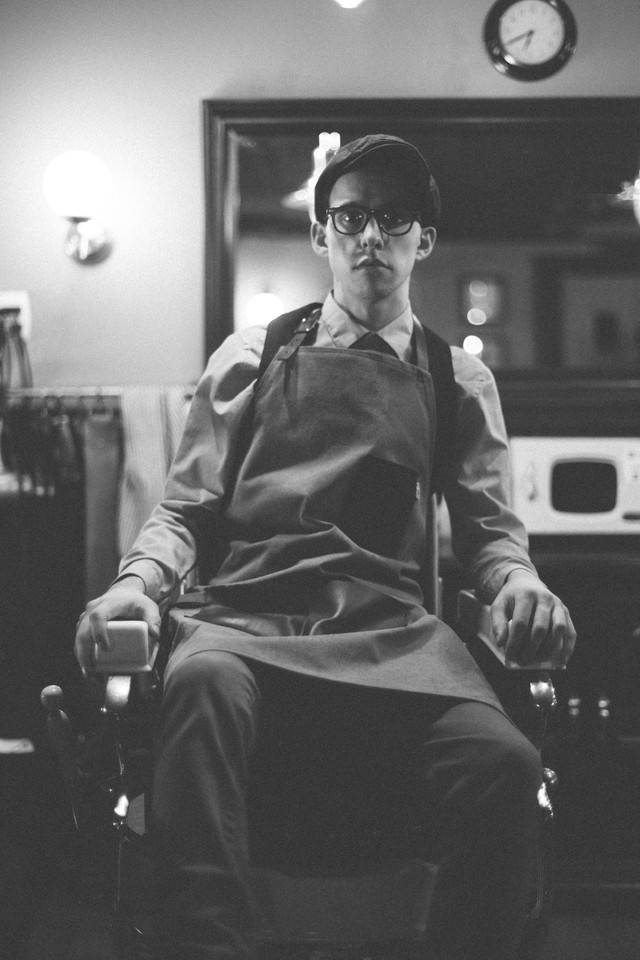 Portrait of Reise Sitting in Barber Chair