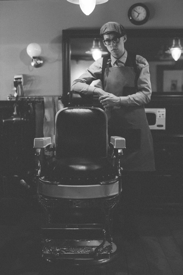 Portrait of Reise Leaning on Antique Barber Chair