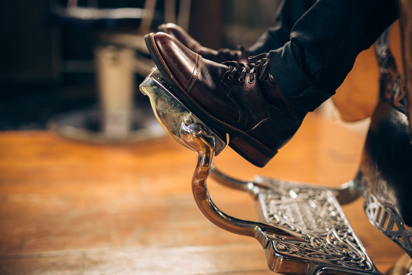 Boots on Footrest of Antique Barber Chair
