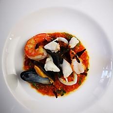 Squid Ink Ravioli, Crab Meat, Shrimp & Squid in Spicy Coriander Tomato Sauce