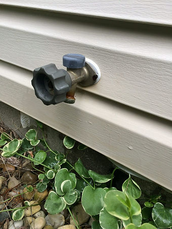 clean siding under spigot.jpg