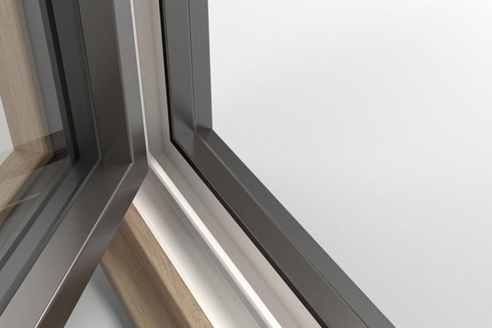 Finestra FIN-Ligna in legno massiccio, alluminio e PVC