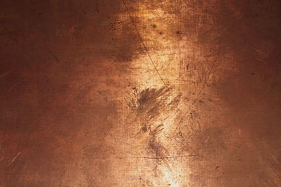 Copper surface. bronze background. metal plate with spots and scratches. brown grunge text