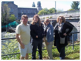 Brian Nolan tells stories from Galway City History at the Salmon Weir bridge beside Galway cathedral on the river Corrib with American visitors,. Galway walking tours and Galway walks are really the best way to get to know Galway city