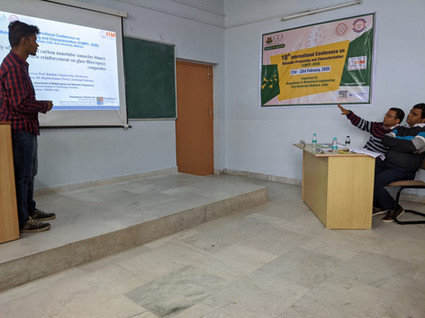 Scholar Bhaskar Sen presenting his work at a conference held at GLA University, Meerut
