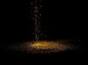 Sprinkle gold dust on a black background