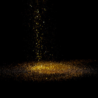 Sprinkle gold dust on a black background