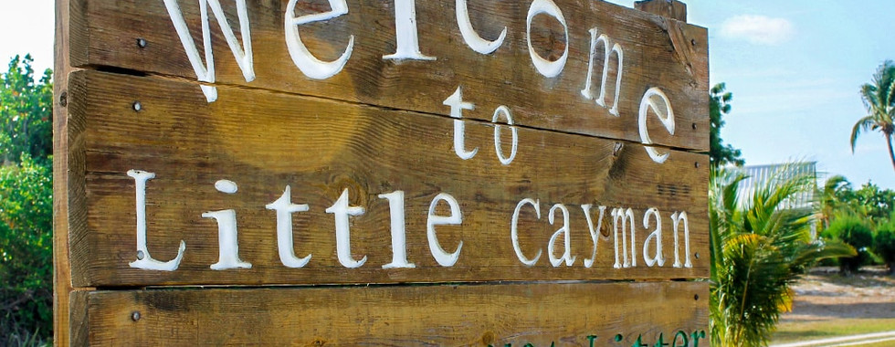 little-cayman-welcome-sign-1060x834-min.