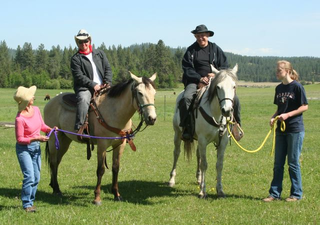 Father daughter veterans on horseback