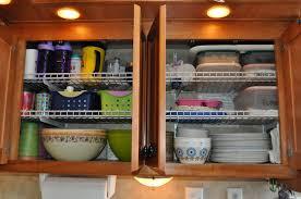 dishes in a RV motorhome cupboard