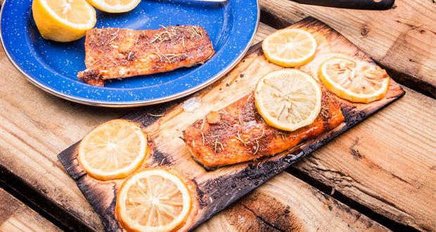Salmon grilled on a cedar plank over an open fire