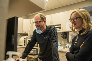 Dr. Dave Ducommun and Dr. Kourtney Kuyper discuss with one another to determine the best care for patients.