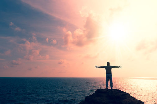 Man rise hands up to sky freedom concept
