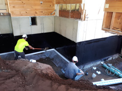 showing new footing drains being install