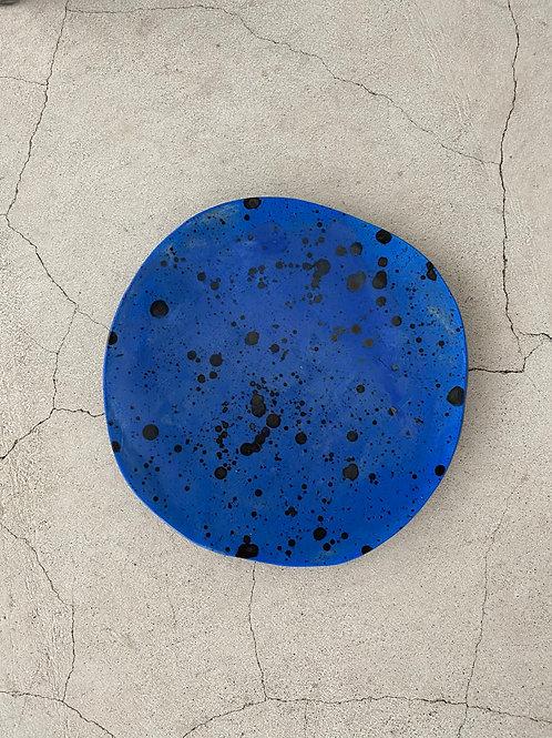splatter black on blue