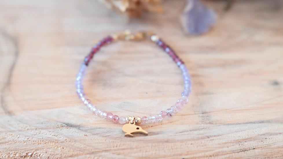 View of 3 of gemstones - Strawberry quartz, Amethyst and Rhodolite Garnet with a Kiwibird charm, surgical steel bracelet
