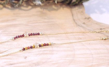 View of two bracelets with 3mm natural gemstones, a little golden Swarovski crystal star  in the middle