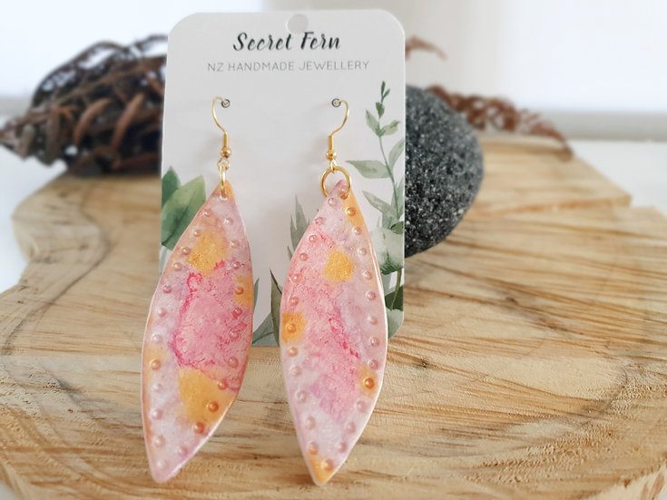 Gold and pink statement earrings