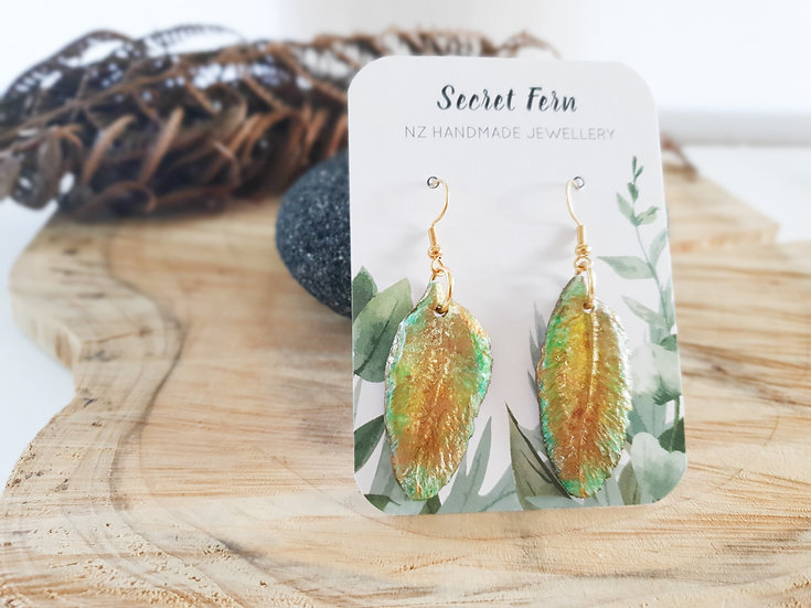 Green and golden feather earrings