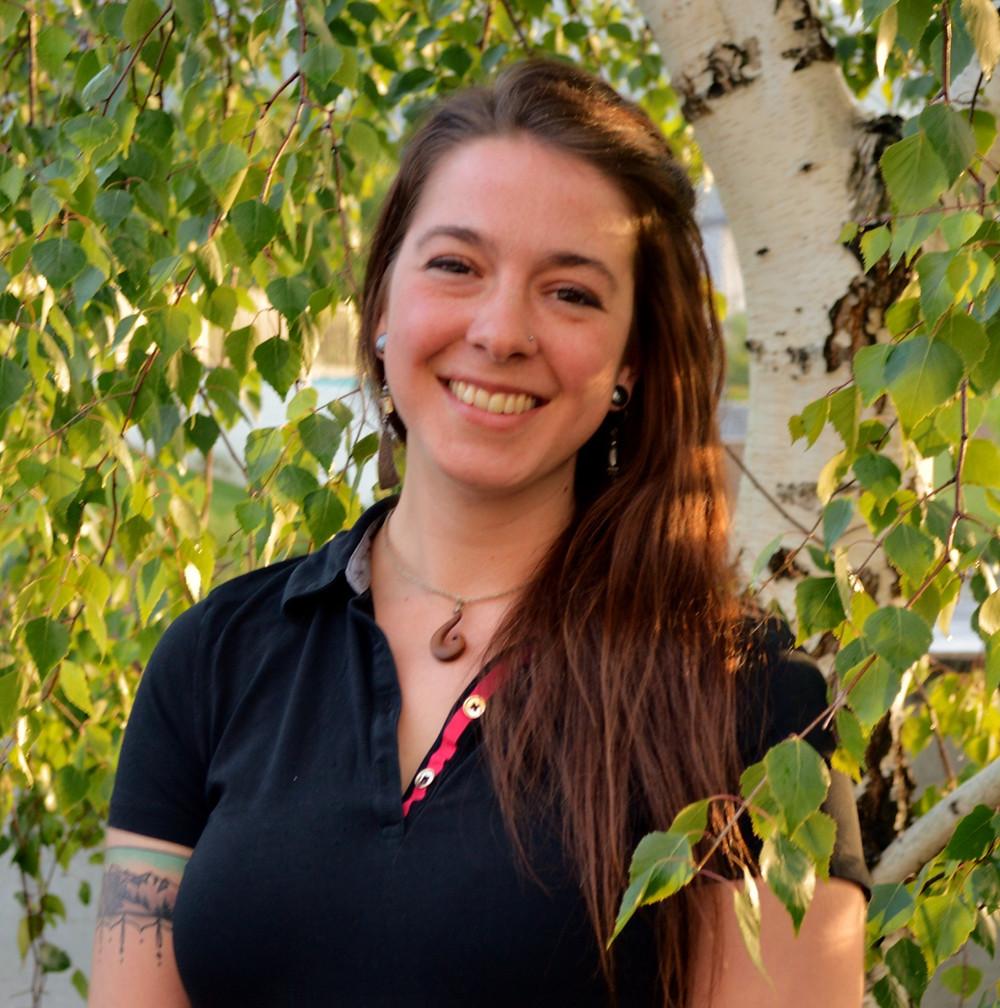 Raven Borgilt, LMT smiles at the camera.