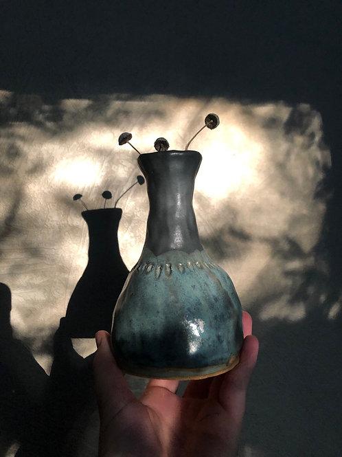 Black and blue vase