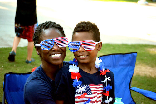 Mother and son with Independence Day sunglasses