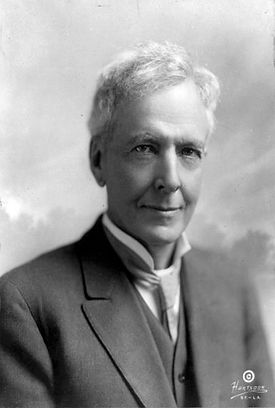A black and white photograph of Luther Burbank wearing a suit. He has shortish grey hair an a clean shaven face.