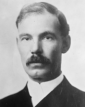 A portrait of Edward Ross. He is a middle aged white man with a mustache.