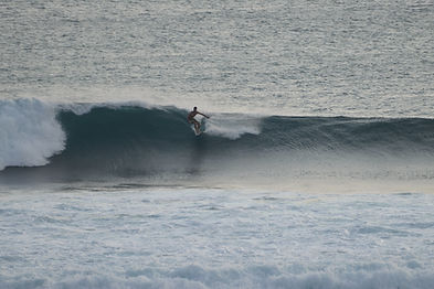Surfing at mawi wave near kuta lombok