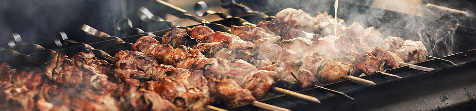 bbq header of shi kebob on the grill