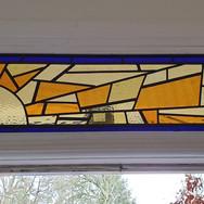 14. Sunbeam door - Leaded door panel installed