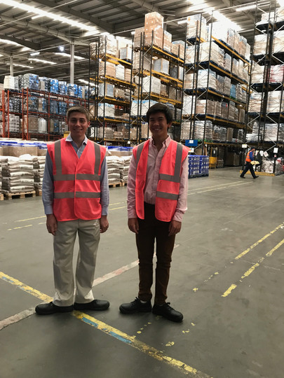 Nick and Nick stand at attention in a Cabot warehouse