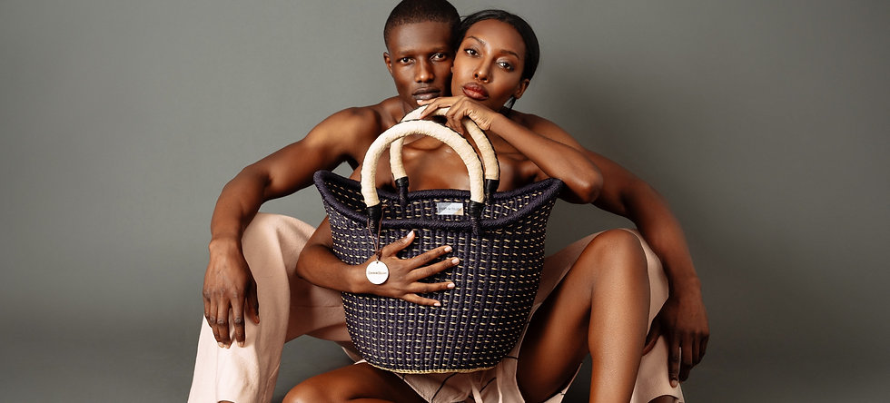 Man and woman modeling a basket