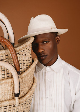 black man in white straw hat with africa