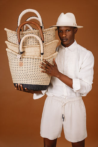 African straw basket with leather handles