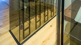 Frameless glass wine cellar