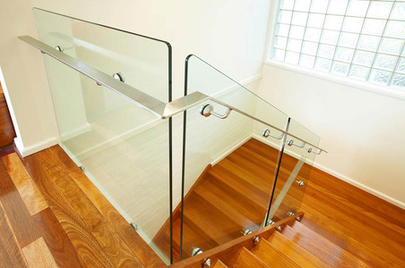 pin fixed glass staircase with offset handrail and radius corners