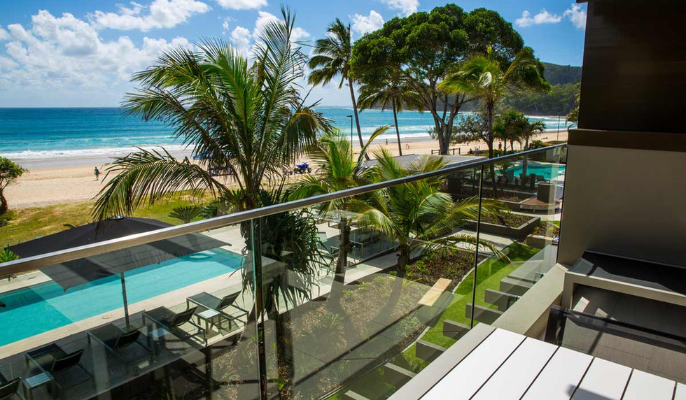 Glass Balustrade with view of the ocean ]