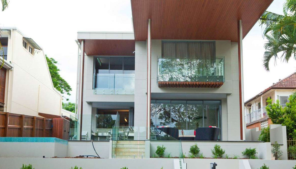 House with external balustrade and pool fence