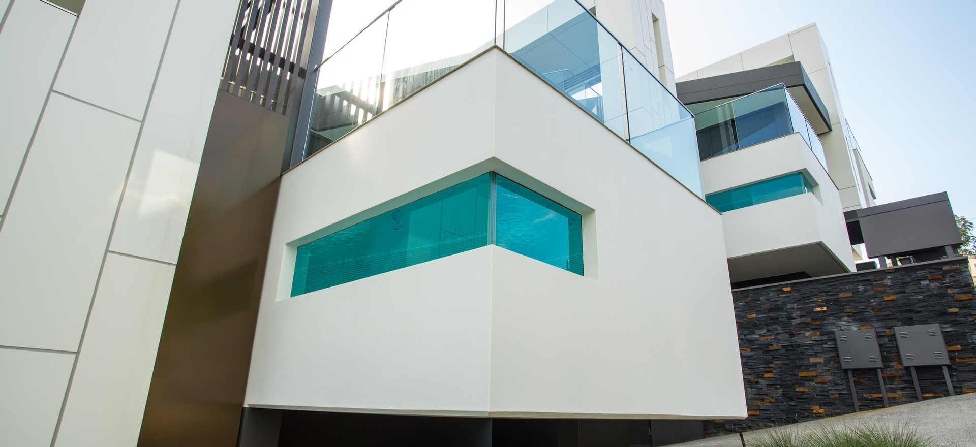 Glass pool window with balustrading on top
