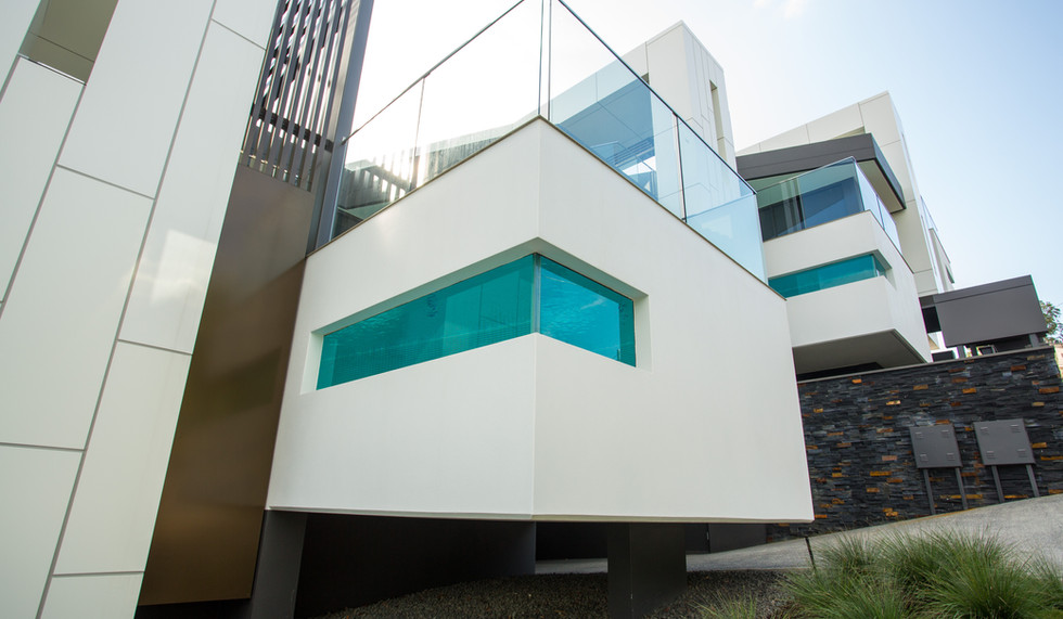 Glass pool window with balustrading on top