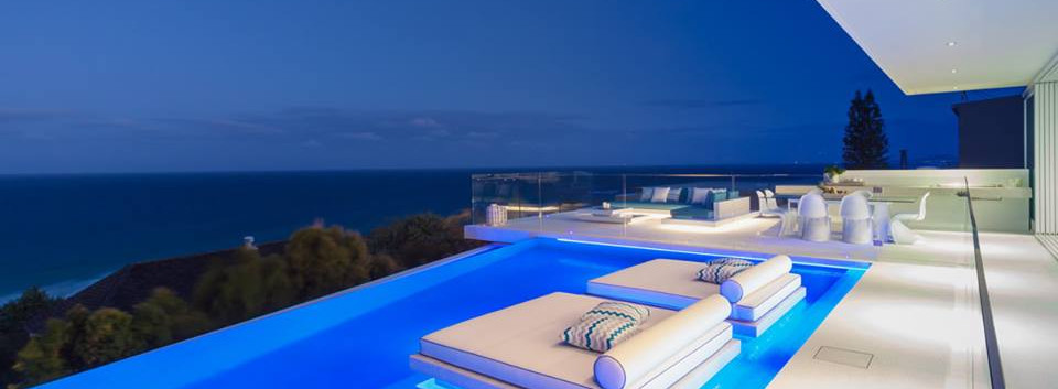 Custom pool fence with a view of noosa