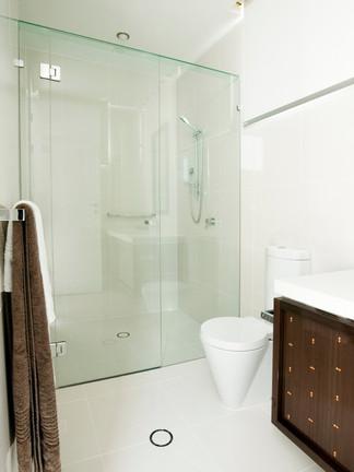 frameless showerscreen with header brisbane