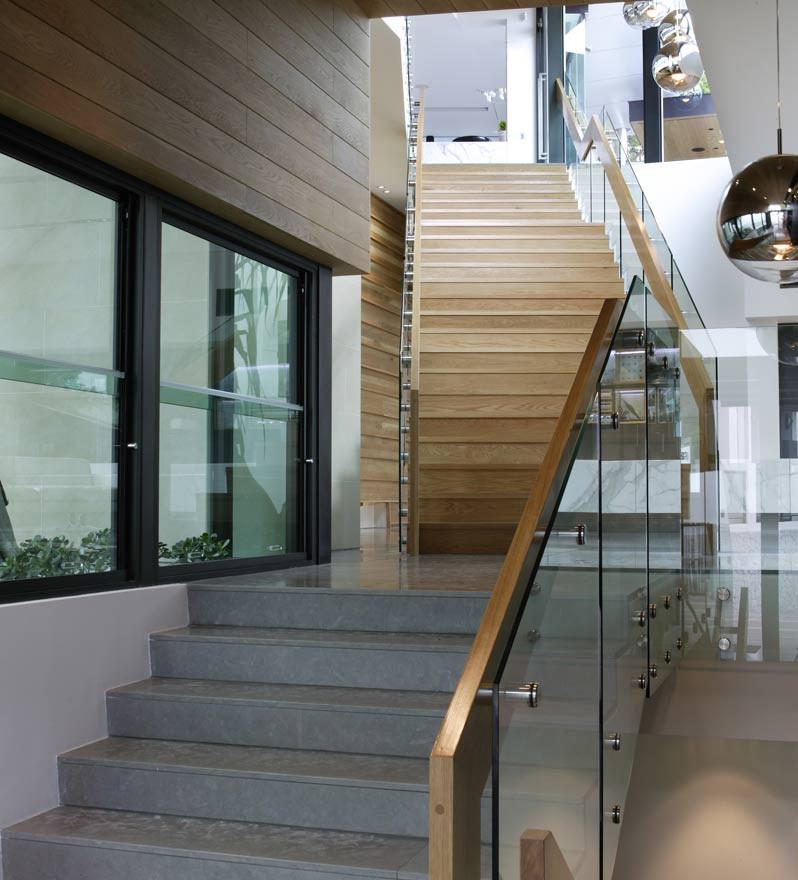 Internal glass staircase with custom rail