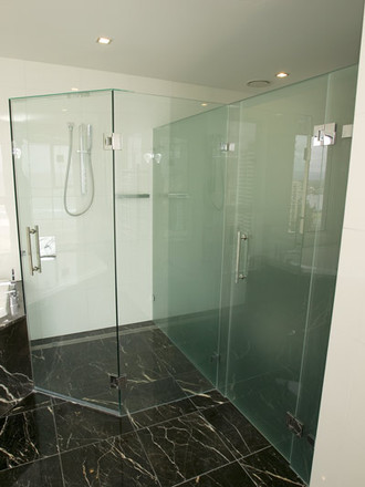 Framless quadrent shower screen installed by euroglass